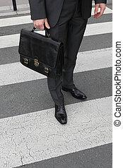 Man crossing at a pedestrian
