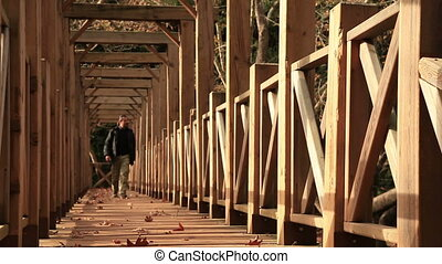 Man crossing at the bridge