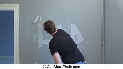 man crossing out the word old on wall