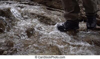 man crossing the creek, walks on the water