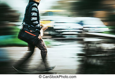 Man crossing the street at a crosswalk.