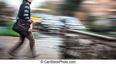 Man crossing the street at a crosswalk.