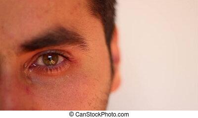 Man Crying Close Up - Suffering man, cries. Close shot of...