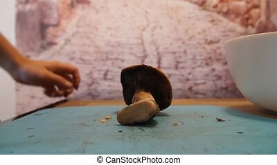 Man cut mushrooms - Man hand cut wild mushrooms. Chop fresh...
