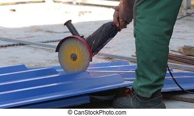 Man Cuts Metal With Grinder - Man cuts metal with grinder...