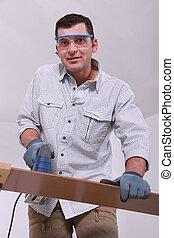 Man cutting a floorboard