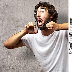Man Cutting Beard against a grunge background