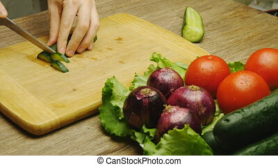Cutting cucumber wooden table - Man Cutting cucumber wooden...