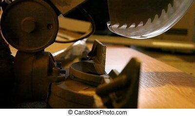 Man Cutting Flooring with Jigsaw T