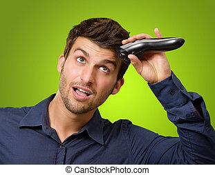 Man Cutting His Hair With Razor