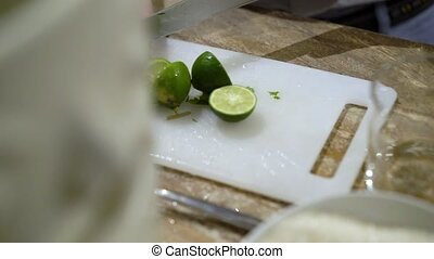 Man cutting lime with knife