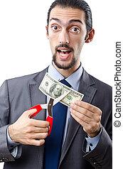 Man cutting money on white