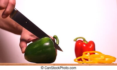 Man Cutting Peppers