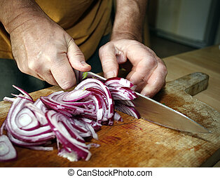 Man cutting red onion