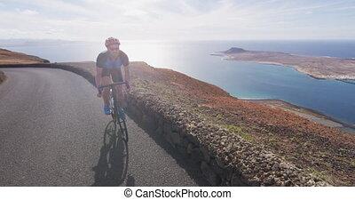 Man cyclist biking on road race cycling on racing bike. ...