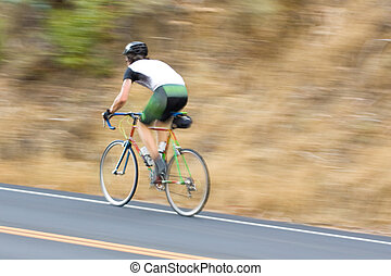 Man cyclist racing past