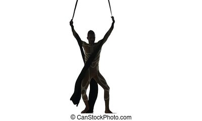 Man dancer on aerial silk, aerial contortion, aerial ribbons, aerial fabric in posing exercise