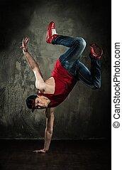 Man dancer showing break-dancing moves