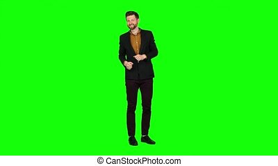 Man dances, flirts, winks, and there are eyes. Green screen...