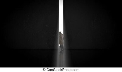 Man dances in a white suit on a black background