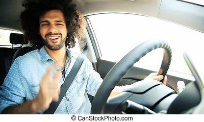 Man dancing and singing driving car