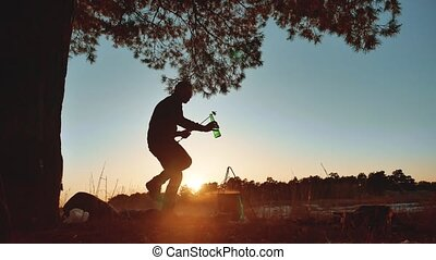 man dancing at a party on nature fun funny silhouette of...