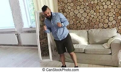 Man dancing at home. Rotating camera. Crazy and fun...