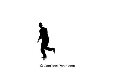 Man dancing breakdance professionally moves and turns, white, silhouette, slow motion