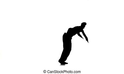 Man dancing breakdance professionally moves, white, silhouette, slow motion