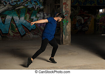 Man dancing in an abandoned building