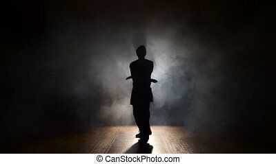 Man dancing in the dark.
