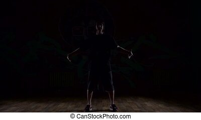 Man dancing in the dark light