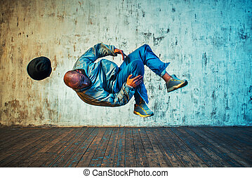 Man dancing on wall background