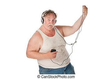 Man dancing to music on handheld audio device