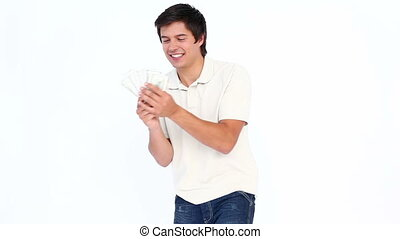 Man dancing while holding dollars