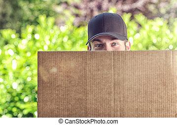Man delivering a large cardboard box