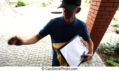 Man delivering a package and asking for a signature film
