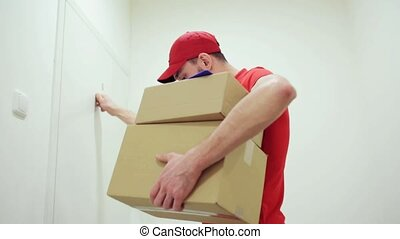 man delivering parcel boxes to wrong customer - delivery,...