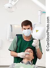 Man Dentist Preparing X-ray