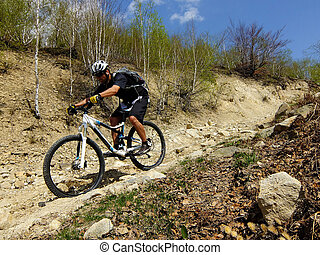 downhill - man descending a steep trail, downhill style
