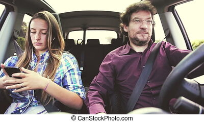 Man driving car desperate about daughter not talking to him