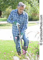 Man digging garden