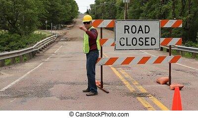 man directing traffic
