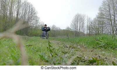 man disabled moving rides wheelchair riding walk video on...