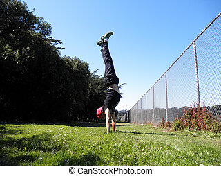 Man does Handstand in Golden Gate Park along fence in San ...