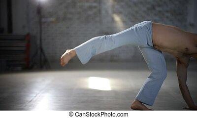Man doing a cartwheel - Showing capoeira elements - Showing...