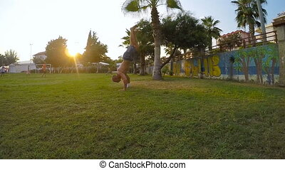 Man doing a handstand in a athletic