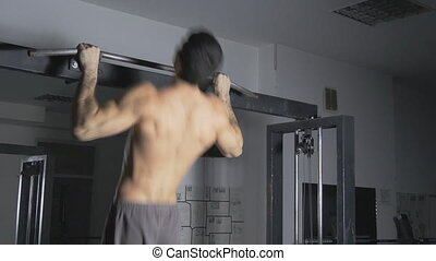 Man  doing a Muscle Up in gym