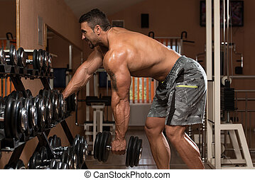 Man Doing Back Exercises In The Gym