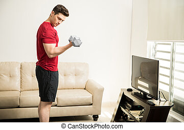 Man doing bicep curls at home